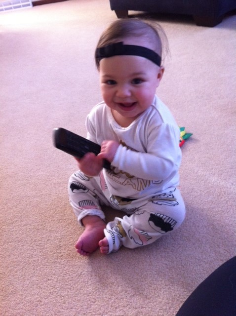 [Image: Baby-with-TV-remote.jpg]